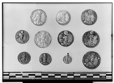 Obverse of Eleven Sasanian Coins, Including Several of King Narseh, King Hormizd II, and King Shapur II [graphic]