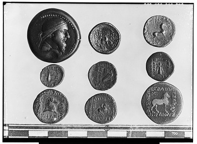 Obverse and Reverse of Nine Coins Depicting Human Head or Animal Design [graphic]