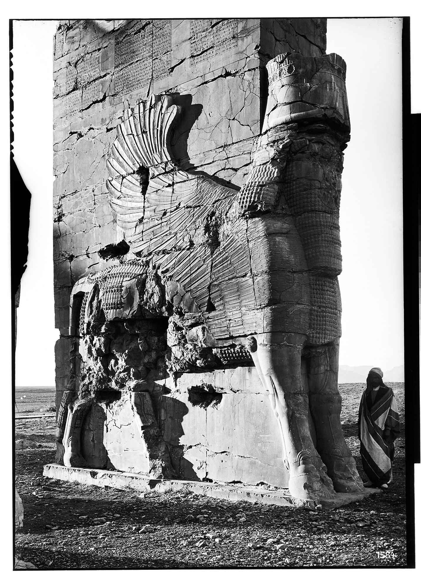 images for Excavation of Persepolis (Iran): Gate of All Lands, Colossal Sculpture Depicting Man-Bull: View before Excavation, Looking West graphic