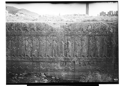 Excavation of Persepolis (Iran): Apadana, North Side, East Wing of Ceremonial Stairway with Reliefs Depicting Guards and Dignitaries: View before Excavation [graphic]