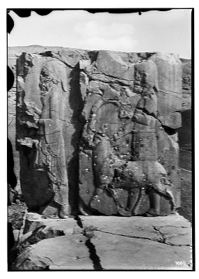 Excavation of Persepolis (Iran): Hadish (Palace of Xerxes), Eastern Apartment, East Jamb of Southern Window: View of Relief Depicting Persian Servant Leading a Median Servant with a Male Adult Ibex [graphic]
