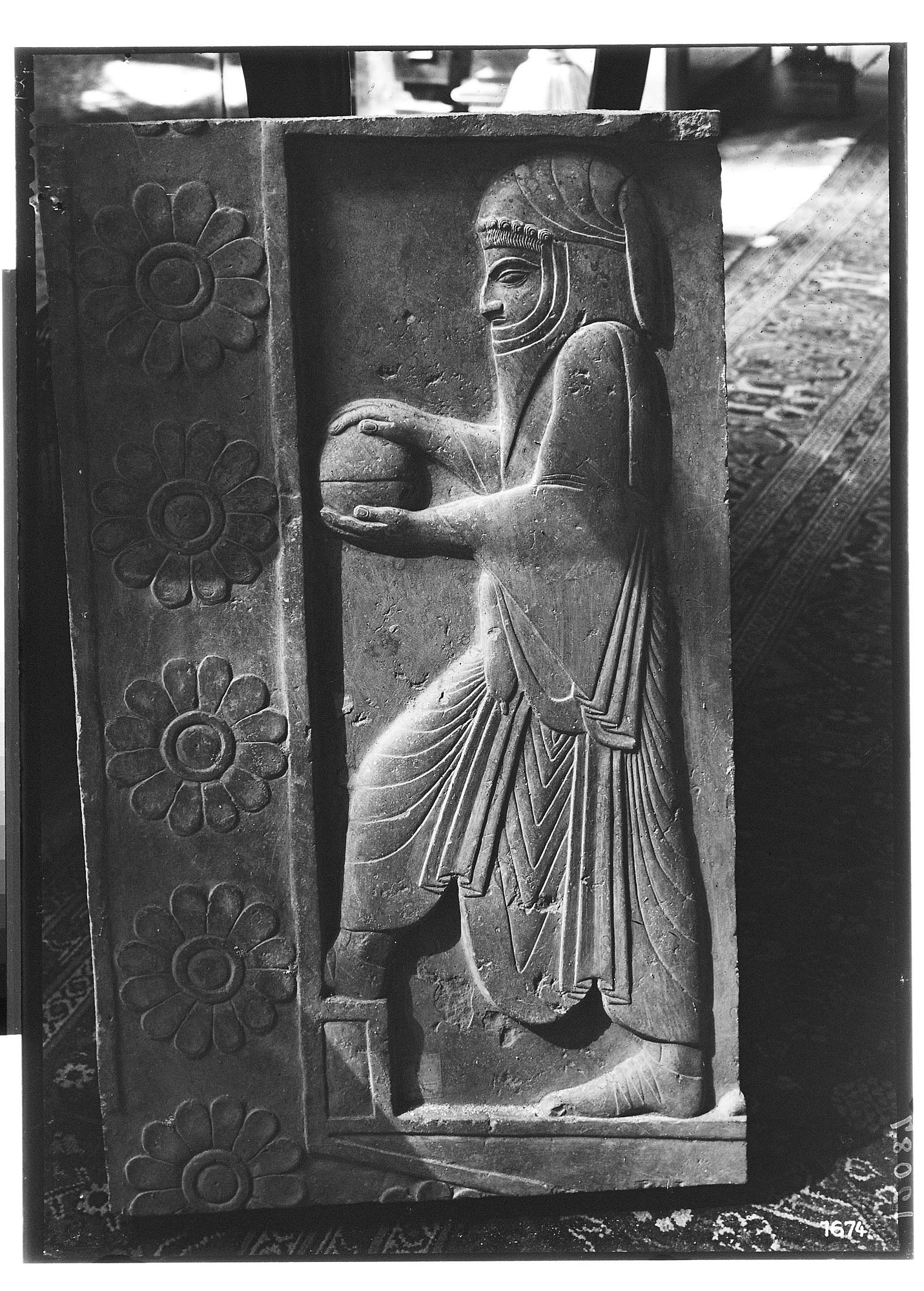 images for Excavation of Persepolis (Iran): Stone Relief Fragment Picturing a Servant graphic