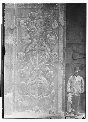 Taq-i Bustan (Iran): Sassanid Rock Reliefs, Large Vault with Investiture Relief of Khusro II: View of Relief Depicting Blossoming Plant in the Shape of a Tree, from the Left Pilaster Flanking the Opening Facade [graphic]