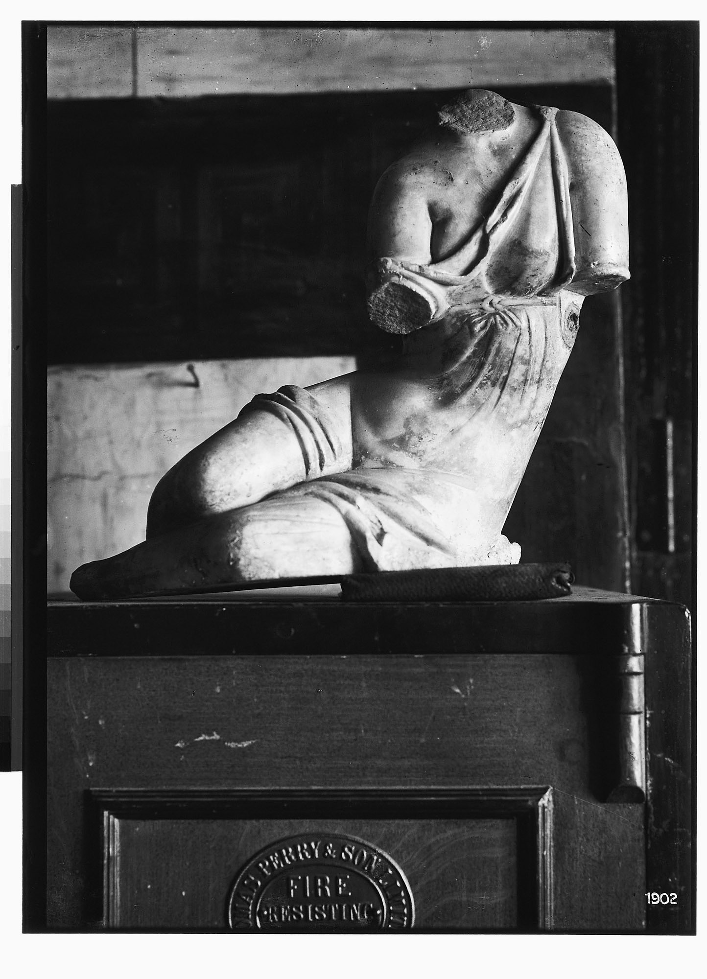 Fragmented Marble Sculpture Depicting a Female Figure Playing Dice [graphic]