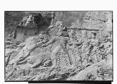 Sar Mashhad (Iran): Sassanid Reliefs Depicting King Bahram II Slaying a Lion While Making a Gesture of Protection towards the Queen, Kartir and Another Dignitary [graphic]