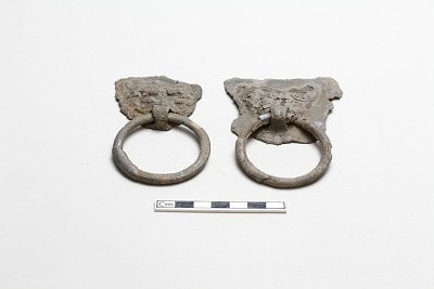 Pair of monster masks with pendant rings