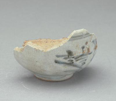 Bowl (waster) with piece of saggar