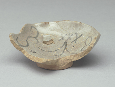 Dish waster (nearly whole), fragment of a rim adhering
