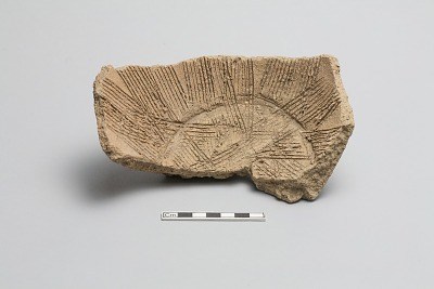 Base fragment of a grating bowl