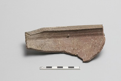 Rim fragment of a large grating bowl, thickened rim with three raised bands on outside