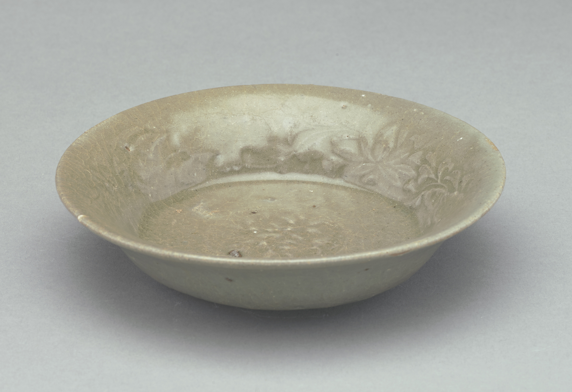 FSC-P-2794; Small dish with everted rim, broad base, no footrim, indented foot