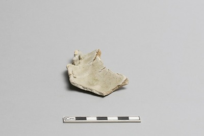 Molded plate with attached ornament, fragment