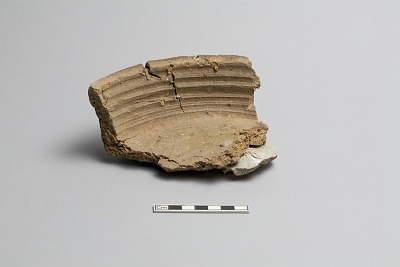 Fragment of molded plate attached to broken saggar