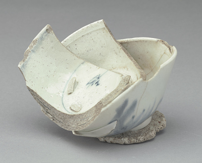 Stack of three rice bowls, fused together on wad of course white clay