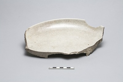 Fragment of large heavy undecorated plate