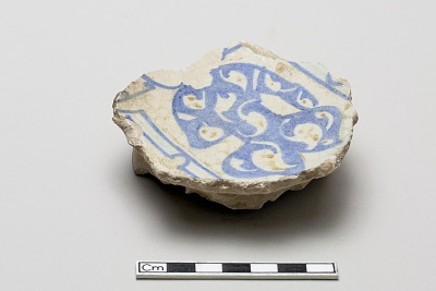 Fragment with a design of a torso