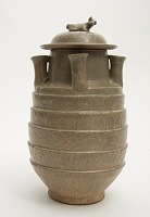 Funerary five-spouted jar with cover for storing grain