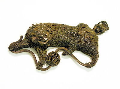 Pendant in the shape of a lion with ball