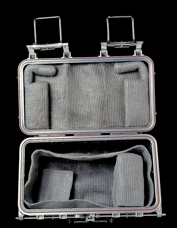Opened ectangular aluminum box padded and lined with metal mesh