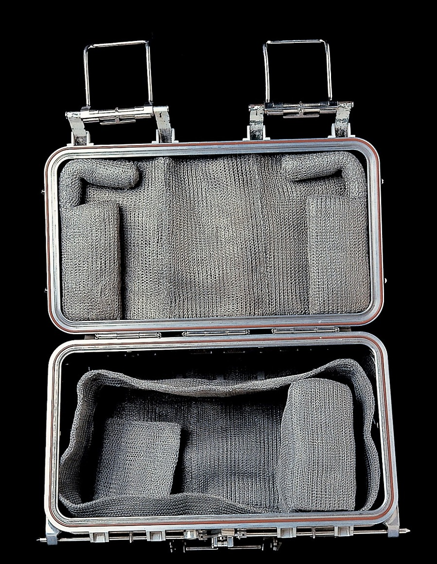 Opened rectangular aluminum box padded and lined with metal mesh