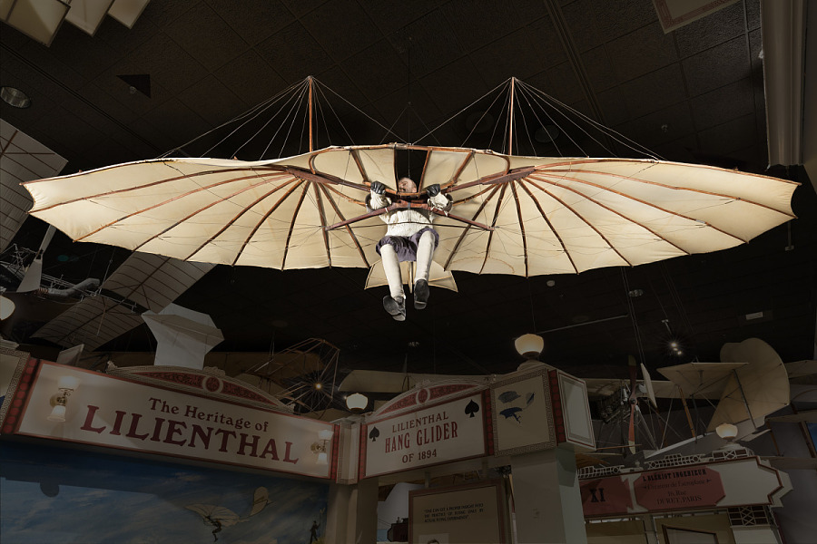 Wing-shaped canvas hang Lilienthal Glider with model hanging in museum