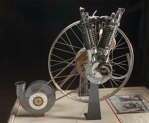 Clement V-2 Engine attached to large wheel attached to small axle