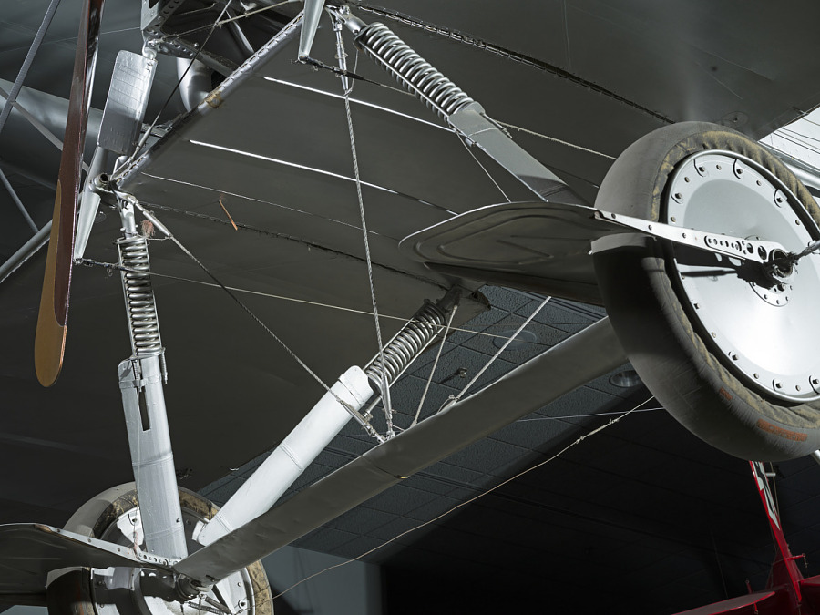 Closeup view of two wheels and metal wheel frame from a Voisin Type 8 aircraft, seen from                 below