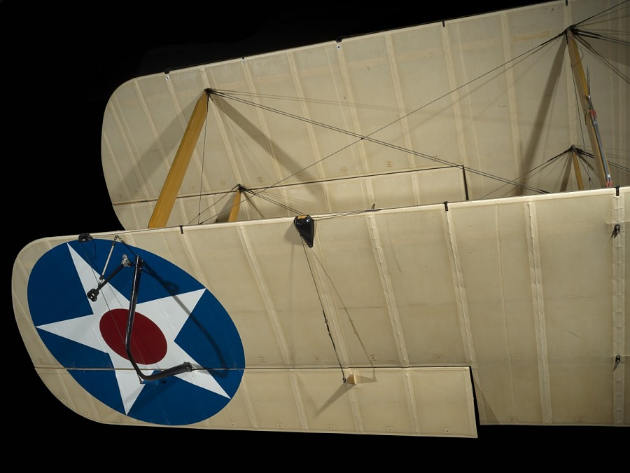 United States Air Force roundel on wing of Tan De Havilland DH-4 biplane