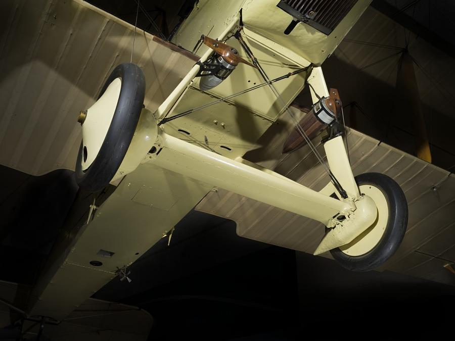 Two wheels and landing gear of tan De Havilland DH-4 biplane