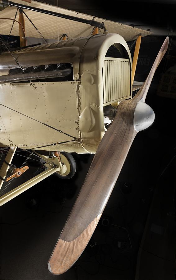 Wooden single-blade propeller on tan De Havilland DH-4 biplane