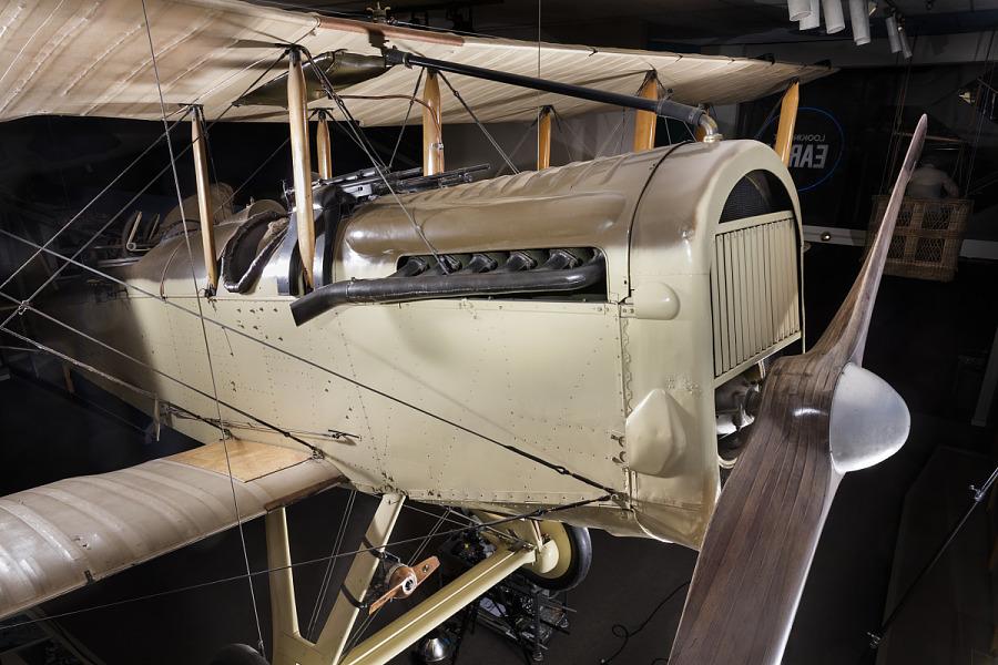 Front engine and single-blade propeller of tan De Havilland DH-4 biplane