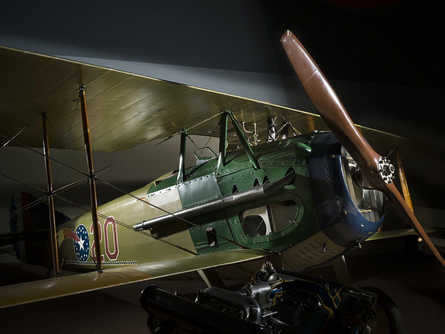 Front engine and cockpit of brown and green Spad XIII 'Smith IV' aircraft