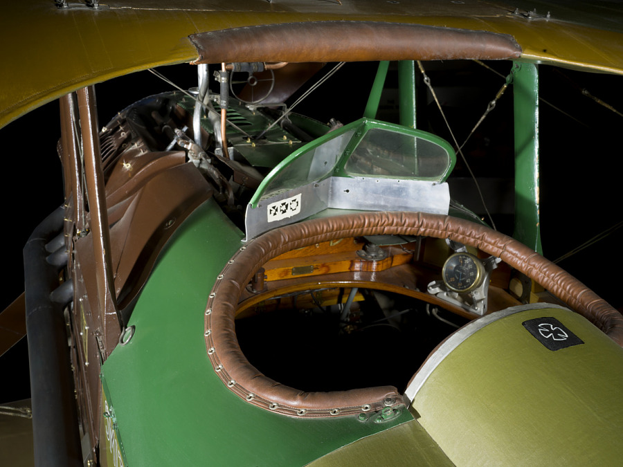 Rear-view of cockpit of green and brown aircraft