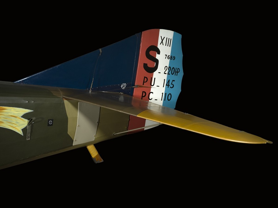 Red, white, and blue stripes and black numbers on tail of Spad XIII 'Smith IV' aircraft