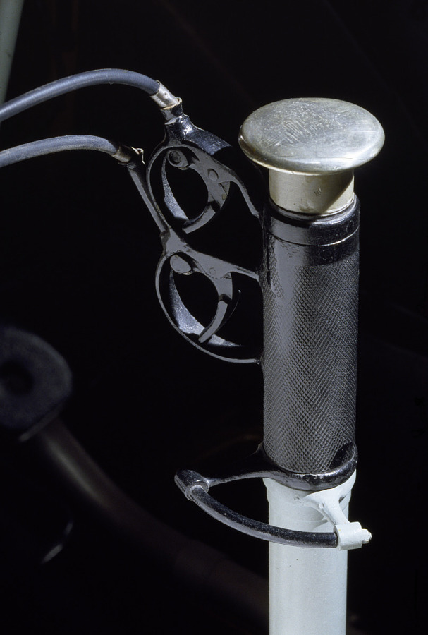 Metal rod-shaped throttle with rubber handle on Spad XIII 'Smith IV' aircraft