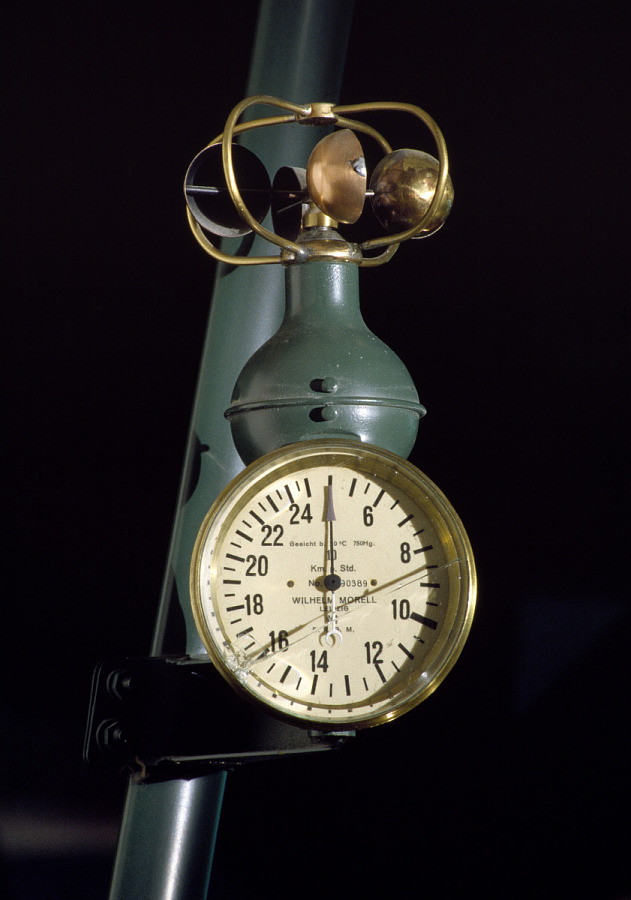Brass air pressure gauge attached to green framing of Fokker D.VII aircraft