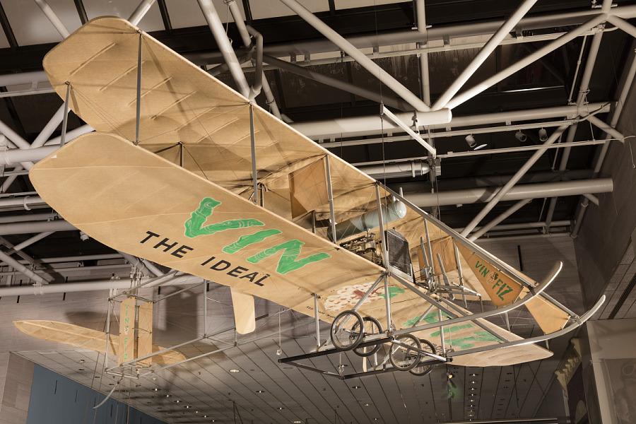 Bottom of Wright EX Vin Fiz biplane with 'Vin Fiz' in green lettering with grape detail