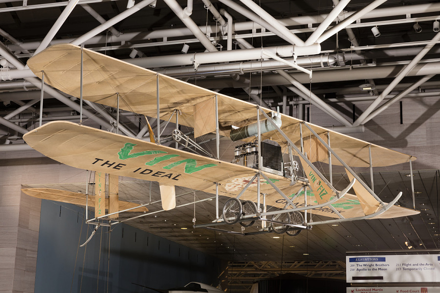 Wood and fabric Wright EX Vin Fiz biplane hanging in museum