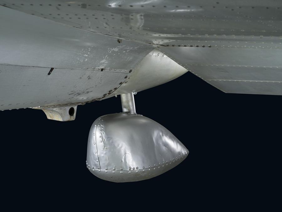 Round bulb-shaped metal rear landing ski on bottom of Northrop Gamma Polar Star aircraft