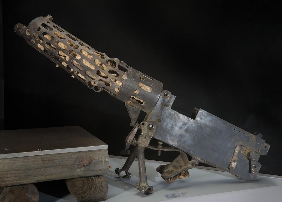 Curved steel machine gun with mounting brackets