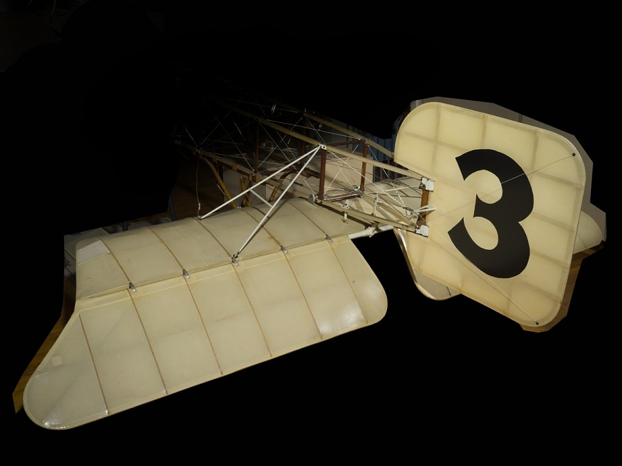 "Back of the Bleriot XI with tail and ""3"" in large black lettering"