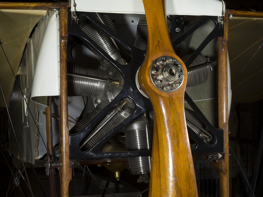 Nose of Bleriot XI aircraft with rotary engine and wooden single-blade propeller