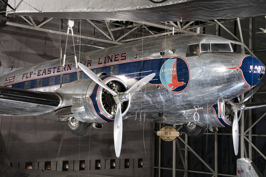 Front engine and nose of twin-engined Douglas DC-3 aircraft hanging in museum