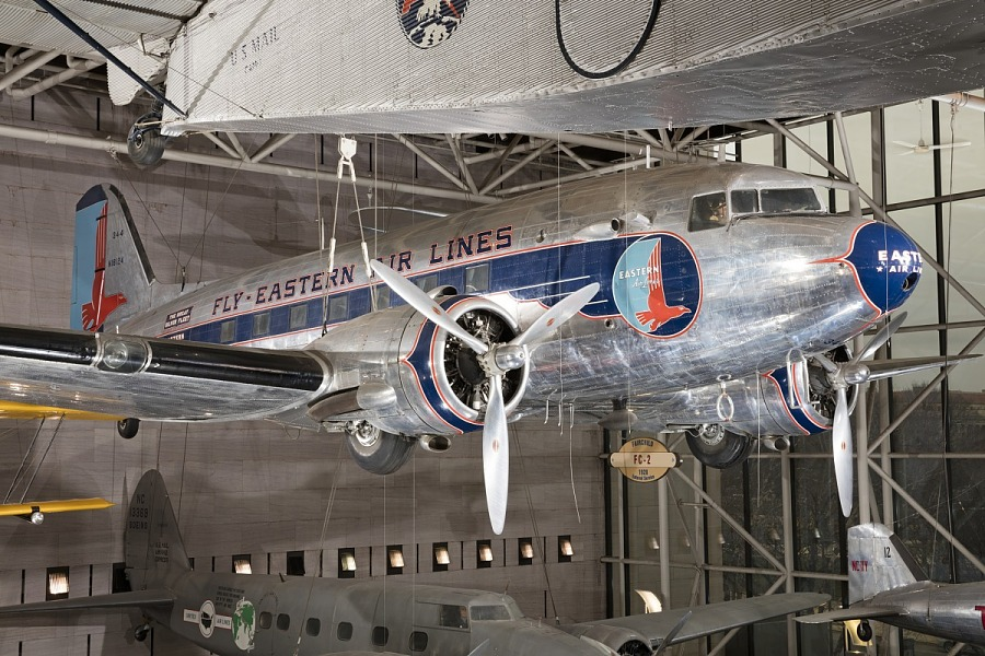 Twin-engined Douglas DC-3 aircraft hanging in museum