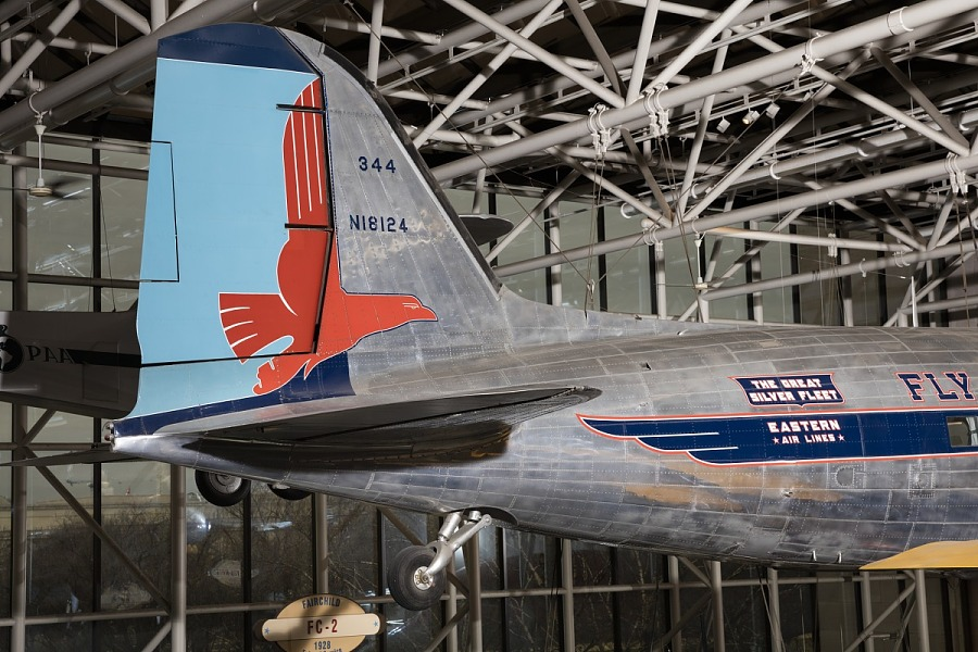 Blue tail of Douglas DC-3 aircraft with red eagle detail