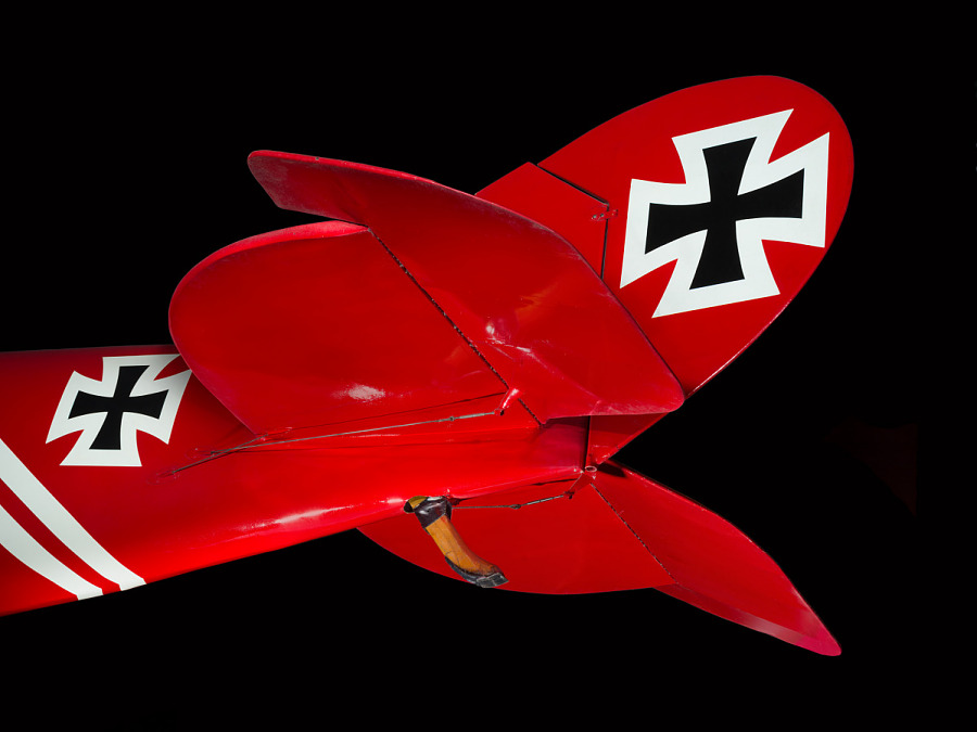 Black cross on tail of red and white Pfalz D.XII aircraft