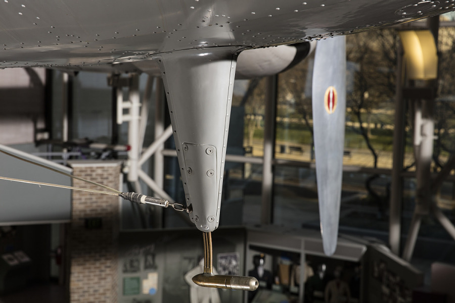 Sharp tool detail under body of gray Boeing 247-D aircraft