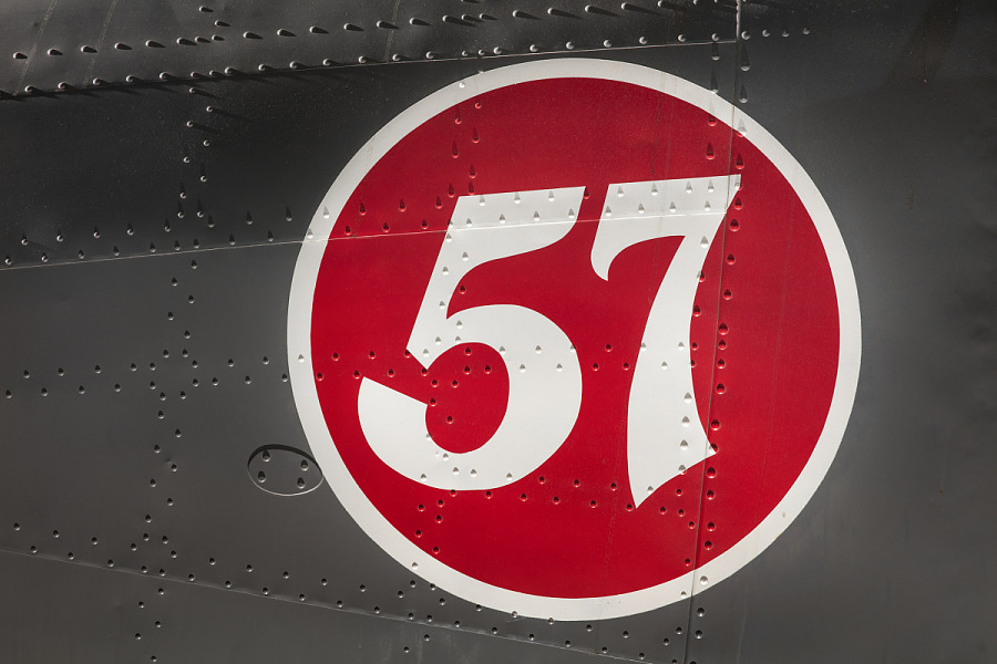'57' in red circle on body of gray Boeing 247-D aircraft
