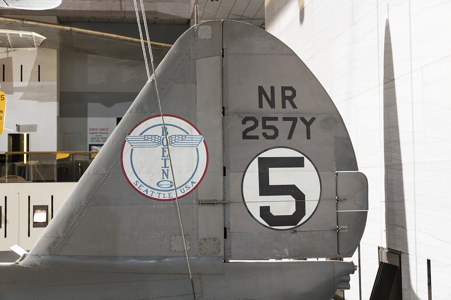 Boeing logo and 'NR257Y' with '5' in white circle on vertical stabilizer on gray Boeing 247-D                 aircraft