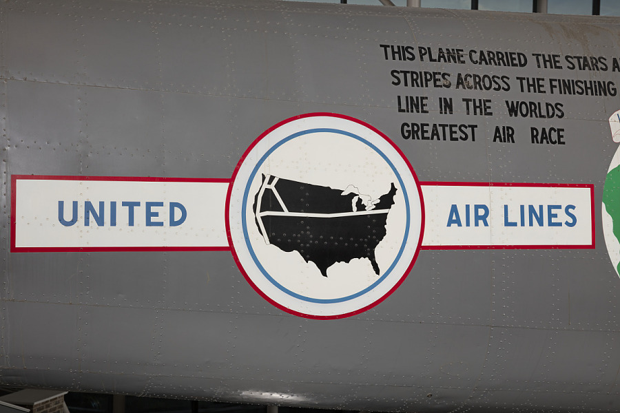 United Air Lines emblem on body of gray twin-engine Boeing 247-D aircraft